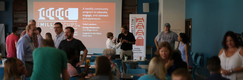 A gathered crowd watches an entrepreneurial presentation at 1 Million Cups Cedar Rapids