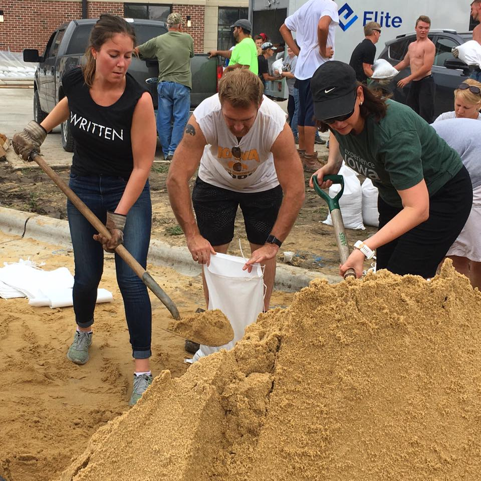 Written Apparel and AssetRover helping fill sandbags for flood prep.