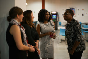 Four people gather and get to know each other at a NewBoCo-hosted event.
