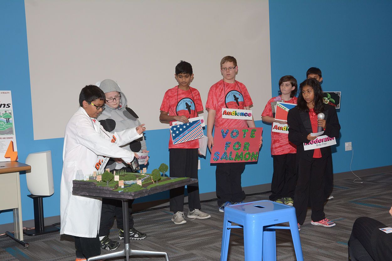 Students practice the presentation portion of their project: communicating clearly to judges how their robot solves the problem.