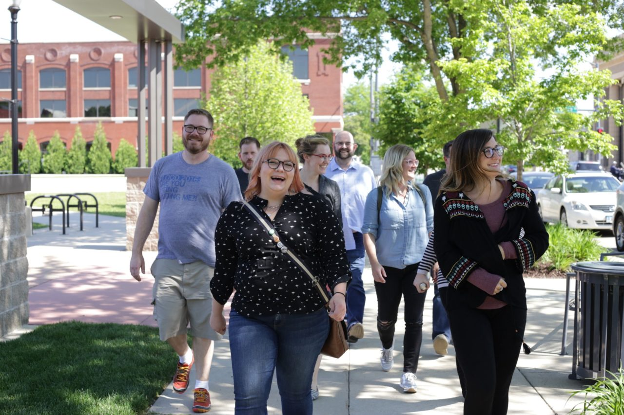 NewBoCo staff laughing and enjoying each other's company as they walk together to a community event