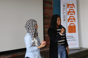 Two high school students present at a 1 Million Cups event