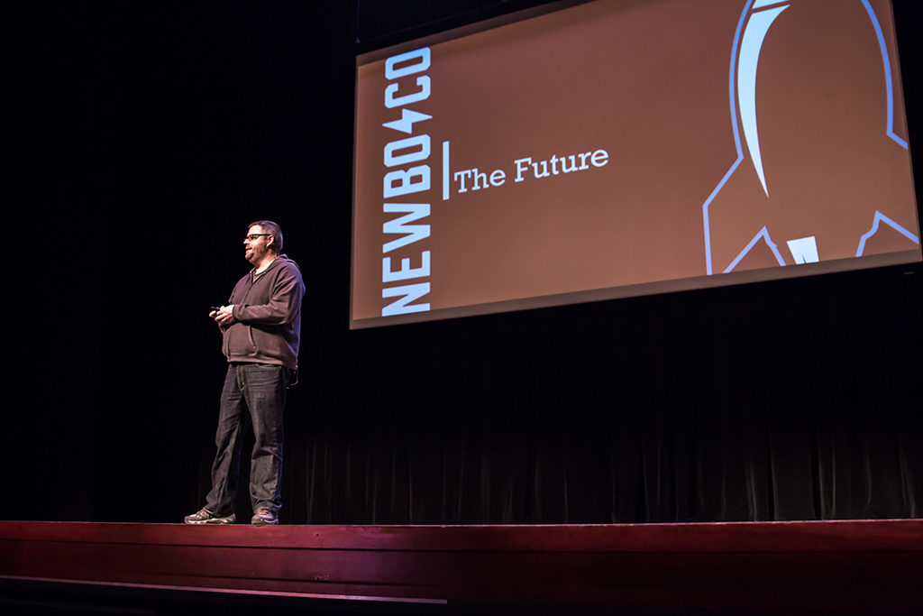 Former CEO, Eric Engelmann presents from a stage on the future of NewBoCo